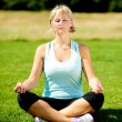 Woman meditating outdoors on a sunny day — Stockfoto