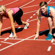 Athletes at starting line on race track — Stock Photo