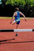 跳过跨栏运动员 — 图库照片