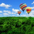 Colorful hot air balloons flying high — Stock Photo