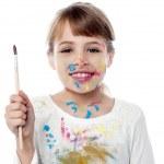 Cheerful kid holding a paint brush — Stock Photo #32595283