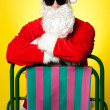 Stylish male santposing with deckchair — Stock Photo #33539297