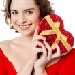 Attractive woman holding valentine gift — Stock Photo