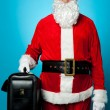 Santa holding brand new briefcase — Stock Photo