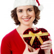 Female santa with Christmas gift — Stock Photo #33539575
