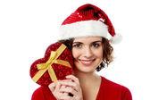 Female santa with gift box — Stock Photo