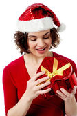 Pretty santa opening the gift box — Foto Stock