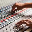 Editor adjusting sound mixer — Stock Photo