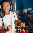 Singer recording his new track in studio — Stock Photo