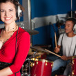 Female singer recording a track in studio — Stock Photo
