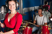 Female singer recording a track in studio — Stock Photo