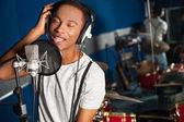 Singer recording a track in studio — Stock Photo