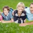 Family enjoying their day outdoors — Stock Photo #34821085