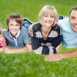 Family enjoying their day outdoors — Stock Photo