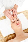 Pretty woman getting head massage — Stock Photo