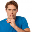 Young male with finger on his lips — Stock Photo #36383463