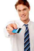 Corporate man offering you credit card — Stock fotografie