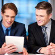 Businessmen browsing on tablet device — Stock Photo