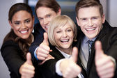 Corporate team gesturing thumbs up — Stock Photo