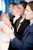 Team of four corporates applauding — Stock Photo