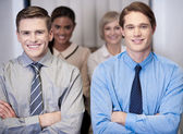 Cheerful work team posing, arms crossed. — Stock Photo