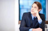 Young classy businessman thinking — Stockfoto