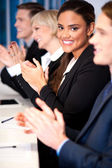 Business team of four applauding — Stock Photo
