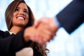 A handshake between business people — Stock Photo