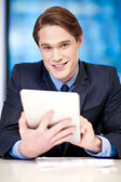 Corporate guy browsing on tablet pc — Stock Photo