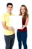 Young love couple with pizza box — Stock Photo