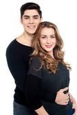 Guy with arms around her girlfriend's waist — Stock Photo