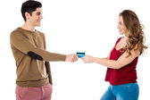 Girlfriend sweetly snatching credit card — Stock Photo