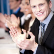 Business associates applauding, focus on guy — Stock Photo
