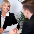 Businesswoman working with her colleagues — Stock Photo