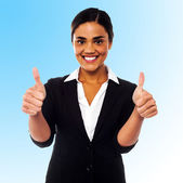 Corporate woman showing double thumbs up — Stock Photo