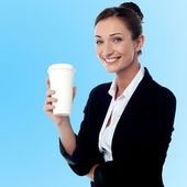 Cheerful business lady holding beverage — Stockfoto
