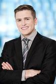 Smiling businessman posing confidently — Stock Photo