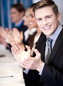 Business associates applauding, focus on guy — Stock Photo
