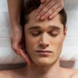 Young man getting spa treatment — Stock Photo #38461999