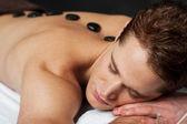 Man having massage at spa — Stok fotoğraf