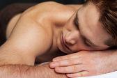 Man relaxing in a spa — Foto de Stock
