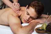 Man getting relaxing massage in spa — Stock Photo