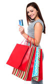 Fashionable female with shopping bags — Stock Photo