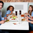 Family eating together in a restaurant — Stock Photo