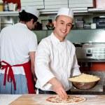 Chefs at work inside restaurant kitchen — Stock Photo #39316049