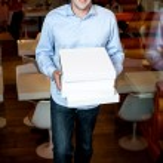 Smart guy holding pizza boxes — Stock Photo #39316059