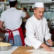 Stock Photo: Chef preparing pizza base