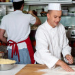 Stockfoto: Chef preparing pizza base