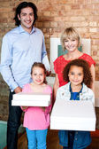 Beautiful little girls holding pizza boxes — Stock Photo