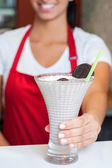 Female chef serving milk shake — Stock Photo